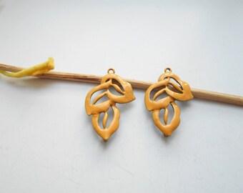 x 2 golden yellow enamel leaf pendant