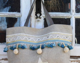 Bag canvas raw linen, Ecru lace, star in Tan Leather, croquet and gold braid, blue stripe pompon, tassels