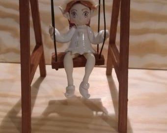 Decorative figurine: Chloe little elf's swing made of cold porcelain.
