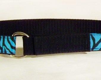 Blue tiger print toddler belt on black web