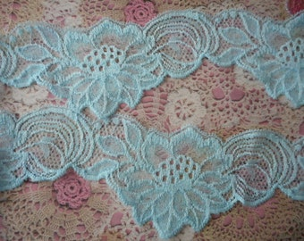 Blue flower patterned elastic lace polyester 7,00 cm width