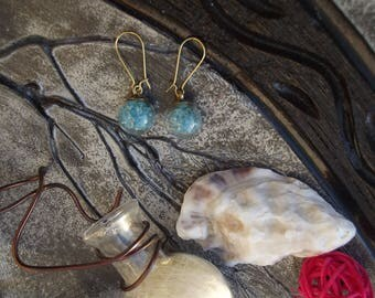 Earrings dangle with hooks sleepers gold and glass globe with small turquoise crystals.