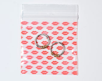 Small silver earrings with snug gold hoops