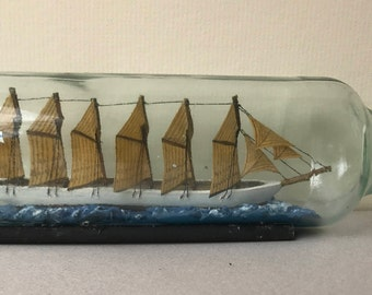 Vintage Handcrafted Model of a Fan Sail Ship in a Bottle.