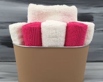 Tan Bathroom Towel/Wash Cloth Bin with  1 white hand towel, 5 dark pink and 5 white wash cloths.