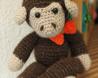 Knitted monkey plush