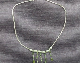 Silver necklace with light green glass beads