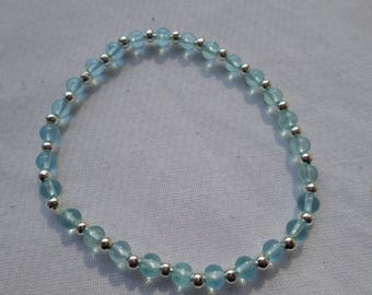 7 inch stretch Bracelet Blue Czech Glass and Silver Spacers