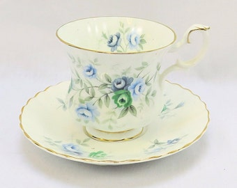 Vintage Royal Albert, Bone China England, ''Inspiration'' Porcelain Cup and Saucer with beautiful Flower Decor