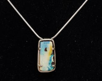 Boulder opal pendant set in Sterling Silver
