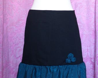 Flared skirt black size 40 - with roses and green ruffle