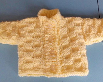 Newborn chunky knit cardigan in lemon. Hand knitted.