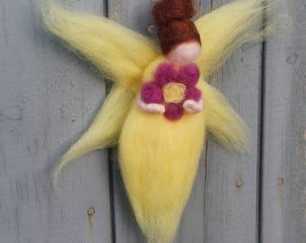 """Yellow fairy with flower fuchsia """"Bleuniek Telia"""" woolen Waldorf Steiner"""