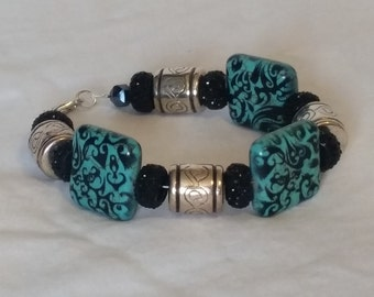 Turquiose square beads with black accents