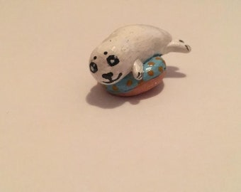 Cute Baby Harp Seal on a Donut Figurine
