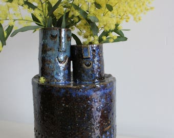 Two headed ceramic stoneware vase