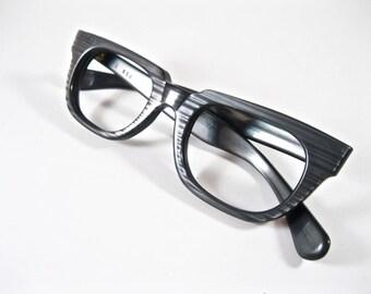 Gray woodgrain horn rimmed glasses. Vintage 1950s 1960s blackwood plastic eyeglass frames. New old stock NOS deadstock no lenses.