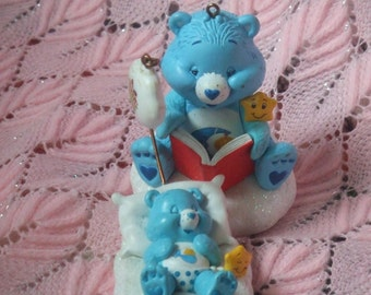 Vintage Care Bears Christmas Tree Decorations. Porcelain and Glitter. Baby in a Coud Bed and Mom or Dad Bear Reading a Book. Very Adorable.