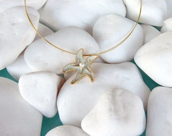 Handmade silver gold plated necklace of a starfish with light blue enamel and a pearl - 18717