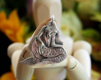 A beautiful hand made mystical mermaid fine silver pendant....