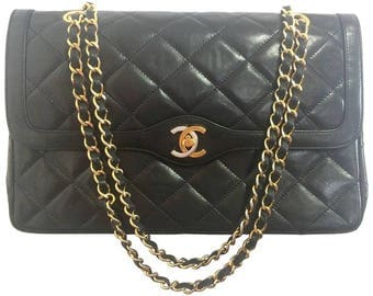 Vintage Chanel black 2.55 classic double flap bag with gold and silver CC motif and chains. Paris limited edition. Rare.