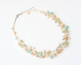 Light blue crystal necklace with orange stone on gold silk thread, short necklace, summer jewelry