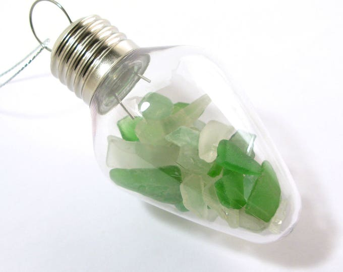 White and Kelly Green Sea Glass Filled Clear Plastic Vintage Light Bulb Christmas Ornament with a Decorative Swirl Hook
