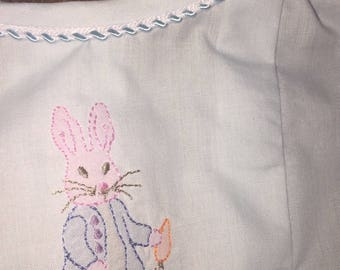 Peter Rabbit on a  baby girl daygown in light blue Imperial batiste,shadow work, tiny blue butons , short sleeves, size newborn to 6 months