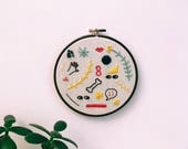 "Embroidery - Large doodles hand embroidered 6.5"" wall hanging (hand, eyes, bone, smiley)"