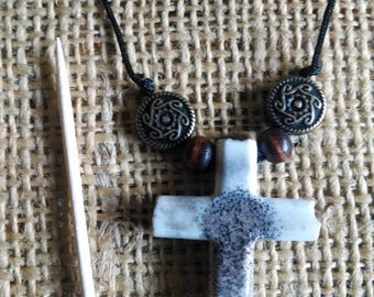 "Cross necklace made of Elk antler...rugged cross is 1-1/2"" long/tall (about 1"" wide) natural color with adjustable black cord"