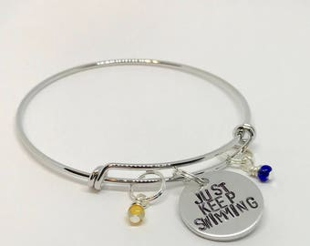 "Finding Nemo Dory inspired hand-stamped bangle bracelet - ""Just Keep Swimming"""