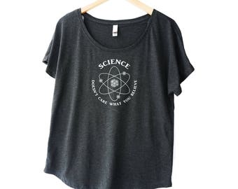 Science T shirt for women. Science Doesn't Care What You Believe printed w 3D atom on a womens flowy t shirt. Plus sizes available.