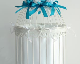 Bird cage large urn with flowers ribbons and lace wedding