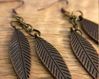 Bronze colored feather drop earrings