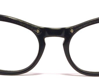 Vintage eyewear. Cat eye style. Made in USA 1950's. Black aluminum brow and sides. Cool up sweep design on front. Hip Cool Urban Woman!