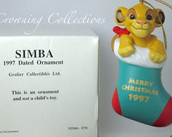 1997 Grolier Simba Annual Disney Ornament Porcelain Dated The Lion King Stocking Vintage Series Scholastic Early Moments Cub in Stocking