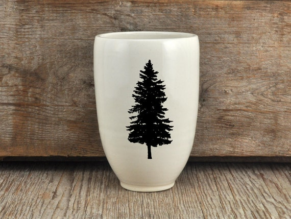 Porcelain beer tumbler with pine tree photograph by Cindy Labrecque