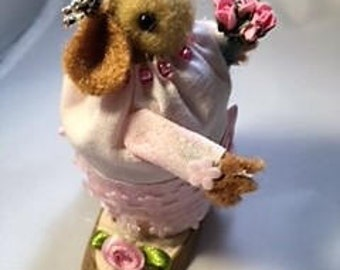 Cute Hamster In Pink Dress Holding A Flower