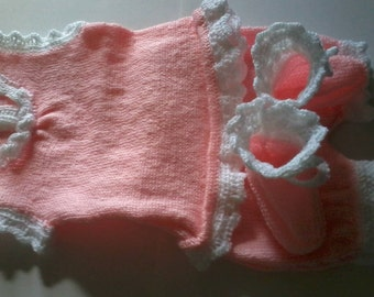 Entire layette, short sleeved sweater, bloomers and booties, pink and white.