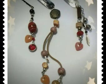 A  set of three  hair jewelry clips