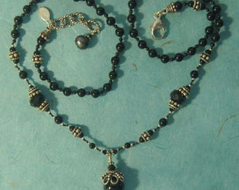 Hand knotted, black onyx gemstone beads, Swarovski crystal and Bali sterling silver beaded necklace.
