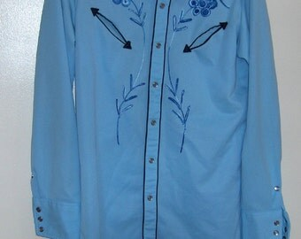 "70s polyester Johnny West men shirt lt blue with embroidery extra long tail tapered approx 20"" from armpit t o armpit and approx 33 "" long"