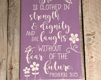 She is clothed in strength and dignity wood sign