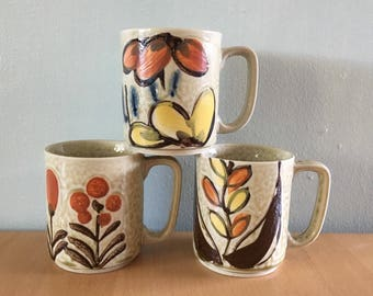 Darling trio of Japanese ceramic coffee mugs / tea cups in earth tones yellow orange blue flowers circa 1970s for your Boho breakfast table!