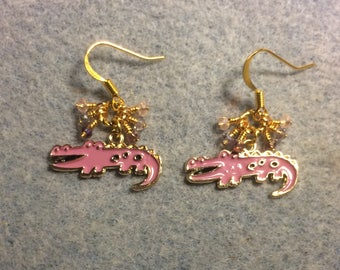 Pink enamel alligator charm earrings adorned with tiny dangling pink and purple Chinese crystal beads.