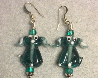 Translucent teal lampwork floppy eared puppy dog bead earrings adorned with teal Czech glass beads.