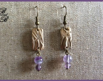 Earrings in bronze and semi precious stones of amethyst, made entirely by hand.