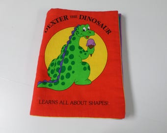 Dexter The dinasaur baby cloth book learns all about shapes great learning book