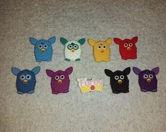 Lot 9 jibbitz Furby (badges for fangs)