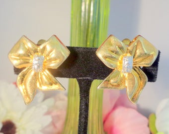 """Use Coupon 10OFF Adorable Gold Plated Bow Style Clip On Earrings with a Single Rhinestone in the Center. The Earrings are 1""""+  & Clip-Ons"""